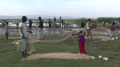 FFishermen soting nets at the shore of Lake Awassa Stock Footage