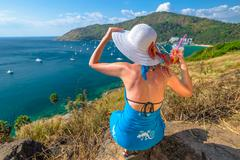 Stock Photo of Woman relaxing at viewpoint