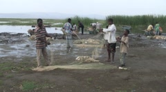 Fishermen at fish market at Lake Awassa sorting net - stock footage