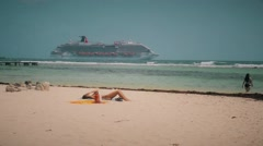 Woman tanning on the beach - stock footage