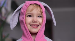 Portrait of a cute little girl dressed in Easter bunny suit Stock Footage
