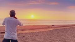 Stock Video Footage of Senior man contemplating sunset