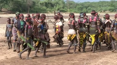 Hamer people women in Omo Valley dancing at whipping passage ceremony Stock Footage