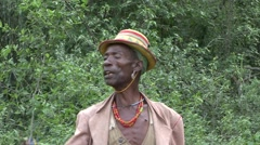 Hamer people man with hat in Omo Valley at whipping passage ceremony Stock Footage