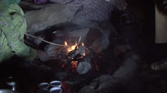 Coffee cermony over open fire in a traditional hut in Simian Mountain - stock footage