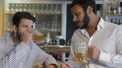 Having a pint with friend - stock footage