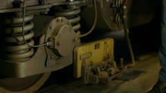 Expert examines the wheels of the train. Stock Footage