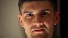 Brutal man portrait looks at camera Stock Footage