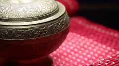 Gold Old Bowl Cup Chinese on a Red Mat Rotating Stock Footage