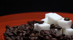Grains of Coffee and Sugar Cubes Close Up Rotating on a Red Plate Stock Footage