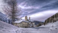HDR timelapse of a chapel in the mountains Stock Footage