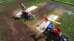 Oil pumps. Oil industry equipment. Aerial view of oil plant in Russia - stock footage