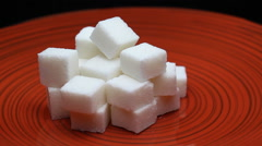 Sugar Cubes on a Red Plate Rotating Stock Footage