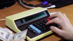 Stock Video Footage of Financial Calculation Money On a Retro Calculator