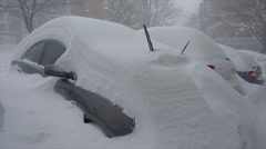 Blizzard 2016: Snowed in parked cars aligned in a row - stock footage