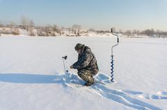 Fisherman looks with this camcorder presence of fish under the ice Stock Photos