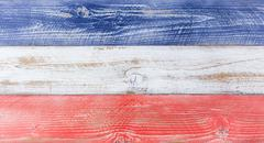 American national colors painted on fading wooden boards - stock photo
