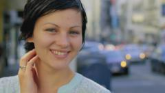 Close Up Of Young Woman Looking To Camera With A City Background Stock Footage