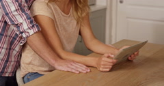 Midsection of a couple using tablet Stock Footage