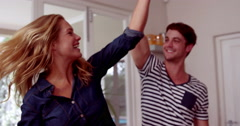 Happy couple dancing in the kitchen Stock Footage