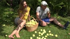 Couple eat apple in garden. Season harvest and vitamin food. 4K Stock Footage