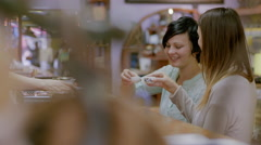 Customers at teahouse cheers the clerk behind counter, smile and drink tea - stock footage