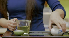 Closeup portrait of girl drinking tea during Chinese tea pouring ceremony Stock Footage
