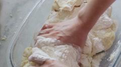 Woman kneading dough. - stock footage