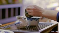 Close up traditional Chinese tea pouring ceremony in slow motion Stock Footage