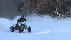 Quick white quad driving on a plowed track - stock footage