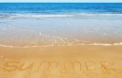 Summer message on the sand - stock photo
