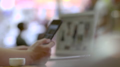 Closeup hands using technology and scrolling images at a cafe, laptop and tablet Stock Footage