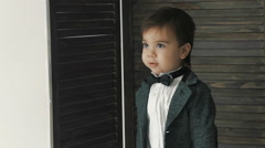 Little cute boy in bowtie smiling, making funny faces, stylish casual kid Stock Footage