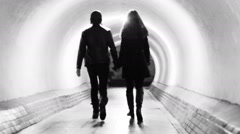 a young couple walking through the tunnel of life - stock footage