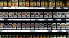 Motion of display seasoning on shelves in organic supermarket - stock footage