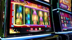 Close up woman playing slot machine inside Hard Rock Casino Stock Footage