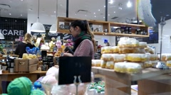 One side of shopper inside Coquitlam Center shopping mall Arkistovideo