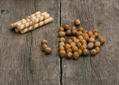The linking of cookies and forest nutlets scattered on a table Stock Photos
