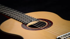 Spanish classic guitar gyrating, detail of mouth, strings, frets and wood Stock Footage