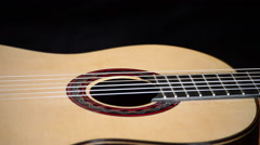 Classic guitar rotating in black background Stock Footage