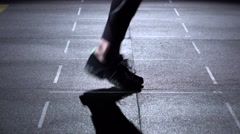 Person jumps on the jumping rope, feet in silhouette, side view Stock Footage