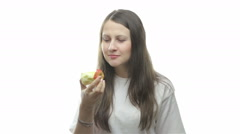 Brunette woman eating apple, eight video - stock footage