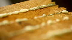 View of wood surface with glue, close-up Stock Footage