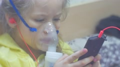 Girl With Inhaler Is Playing with Smartphone Concentratedly Listening to Music Stock Footage