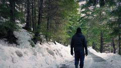 Man Walks On Forest Road In The Snow Stock Footage