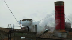 Old plant roof with steam fly over Stock Footage