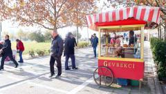 IZMIR, TURKEY - JULY 2015: Boyoz and simit (gevrek) are sold by a street vendor. Stock Footage