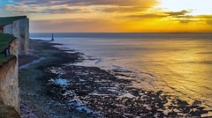 Panoramic view of Seven Sisters cliffs with lighthouse and sea - stock footage
