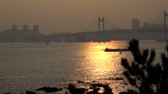 Guangan Bridge from the Dongbaek island at sunset. Busan, South Korea Stock Footage
