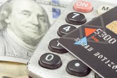 Financial accounting stock market analysis closeup pen, credit card money Stock Photos